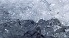 Close-up boiling water in ultra-slow motion, filling the frame - stock footage