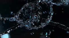 Mirror-image stream of ultra-slow motion water with optical illusion effect Stock Footage