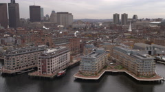 Aerial shot of buildings along Boston Harbor from Fairmont Battery Wharf to Stock Footage