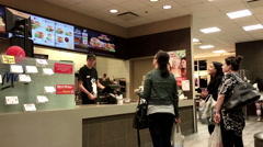 People ordering food at mcdonalds check out counter inside Walmart store - stock footage