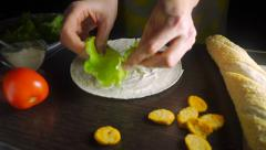 Amateur female cooker making Caesar chicken roll, close up video - stock footage
