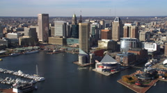 Aerial approach and flyover of downtown Baltimore from the harbor. Shot in 2011. Stock Footage