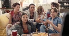 Diverse group of student friends arms raised celebrating goal watching sports Stock Footage