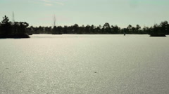 Snowy field on the frozen lake. Clean and frosty daytime. Smooth dolly shot. Stock Footage