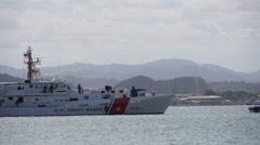 Stock Video Footage of USCG 1115 US Coast Guard light high speed cutter approaching pier.