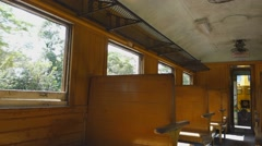 Old Train passenger carriage with wooden bench seat Stock Footage