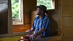 Traveler in old train passenger carriage with wooden bench seat Stock Footage