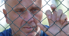 Locked Person Desperate People Closed Area Fencing Protect Secured Transit Zone - stock footage