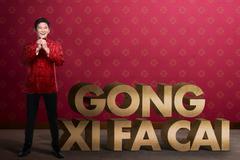 Gong Xi Fa Cai writing and chinese man smiling Kuvituskuvat