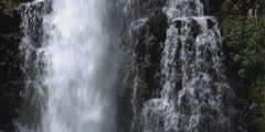 One stream of a waterfall plunging straight down while another beside it drops Stock Footage