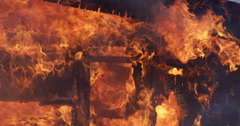 The support structure of a house engulfed in flames Stock Footage