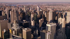 Flying over buildings near New York's Rockefeller Center. Shot in 2006. Stock Footage