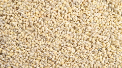 Rotation of a pearl barley (background) Stock Footage