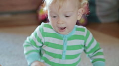 Little boy with mother playing at home Stock Footage