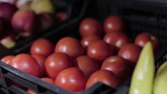 Tomatoes and apples in a grocery store - stock footage