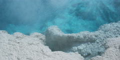 Close-up clear blue water and white mineral deposits of a hot spring - stock footage