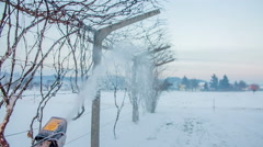 Snowblowing along a vine Stock Footage