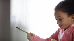 Little girl enjoying her colouring book Stock Footage