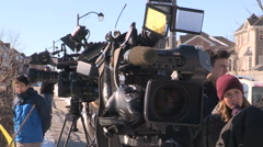 TV news cameras at crime scene gathering for scrum with police - stock footage