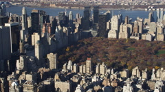 Flying past Central Park in Midtown Manhattan with Hudson River in background. Stock Footage