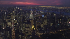 Flying over Upper Manhattan at dusk with Central Park in foreground; looking Stock Footage