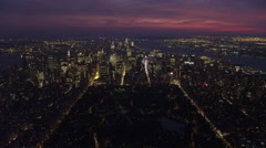 Flying toward Midtown Manhattan at dusk with Central Park in foreground, looking Stock Footage