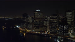 Flying above the East River at night, looking west to Financial District. Shot Stock Footage