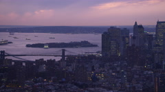 Over Lower Manhattan looking toward Brooklyn Bridge and Governor's Island at Stock Footage