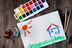 Happy house and bright sun - stock photo