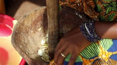 Africa woman smashing onions Stock Footage