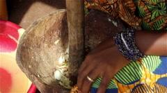 Africa woman smashing onions Stock Footage