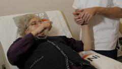 Physiotherapist doing exercises for injured hand with old female patient. Stock Footage