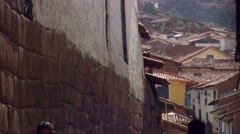 People walking along steep alley in Cusco, Peru Stock Footage