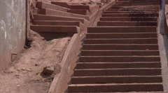 Tilt-up to foot traffic on steep staircase in Cusco, Peru Stock Footage