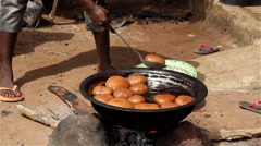 Native villager cooking bread Stock Footage