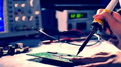 Repairing Electronic Circuits With Soldering Device Stock Footage