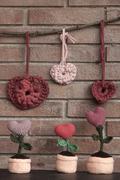 Valentine crochet decorations hearts - stock photo
