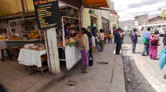 Zoom-in to shoppers and vendors at an open-air meat market in Cusco, Peru Stock Footage