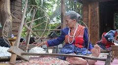 Phu Thai people using spinning cotton thread machine Stock Footage