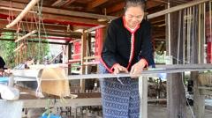 Phu Thai people using Loom or weaving machine Stock Footage