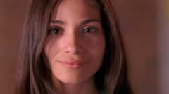 Close-up face of a smiling, brown-eyed girl Stock Footage