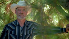 Full-face portrait of a bearded man in a white cowboy hat - stock footage
