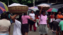 Shoppers in a crowded marketplace in Nahuizalco, El Salvador - stock footage