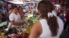 Produce stall in Ecuadorean street market Stock Footage