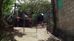 Salvadoran hillside neighborhood, people engaged in various activities Stock Footage