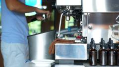 Barista making coffee in background of machine Stock Footage