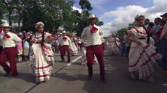 Folk dancers followed by baton twirlers at an Independence Day parade in San - stock footage