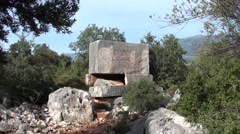 Lycian tomb with modern writings Stock Footage