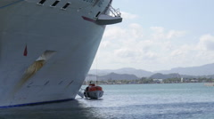 Cruise ship rising lifting retrieving lifeboat from water. - stock footage