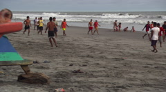 Informal soccer game on a sandy beach in El Salvador Stock Footage